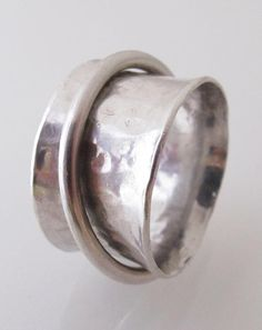 Forged Sterling Silver Spinning Ring  - this was a gift from my husband a few years ago. I wear it everyday. Spinner rings are great for stress! From Susan Lambert's shop on Etsy.