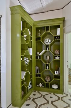 Interesting built-in design.  Any nook can become glamourous display.  Walls created by Jeff Ragland of Holtz, painted in Pickle No. 37, custom color for Fine Paints of Europe. Room by Bridget Beari. My Notting Hill