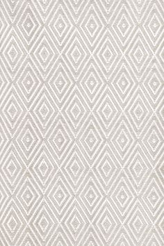 Dash & Albert   Diamond Platinum/White Indoor/Outdoor Rug   A rug for all seasons.  Made of superheroic polypropylene, our indoor/outdoor area rugs are terrific for high-traffic areas and muddy messes. Scrubbable, bleachable and UV-treated for outdoor use, this collection of woven rugs can stand up to all that you dish out.