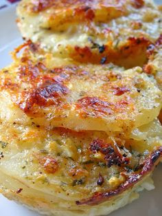 Parmesan Potato au Gratin: 2 garlic cloves, finely chopped 2 tablespoons onion or shallot, finely chopped 2 cups half and half  1 cup parmesan, grated 1/2 teaspoon salt 1/2 teaspoon pepper 1 tablespoon thyme {fresh}, chopped 2-3 medium russet potatoes, sliced thinly