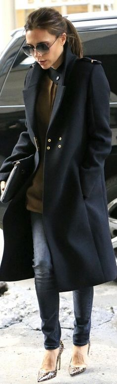 Who made Victoria Beckham's brown long sleeve top, sunglasses, animal print pumps, skinny jeans, clutch handbag, and blue coat that she wore in New York?