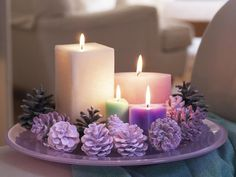 purple pine cones and candles