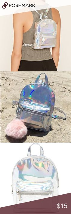 NWT FOREVER 21 holographic mini backpack New with tags holographic mini backpack from f21.  Sold out online! Forever 21 Bags Backpacks
