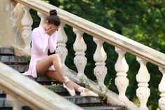 ballerina outdoors - Young beautiful ballerina tired crying on the strairs…
