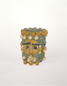 Bead with three human faces. 600-250 BC.Glass. Possibly Carthage/ possibly Eastern Mediterranean.