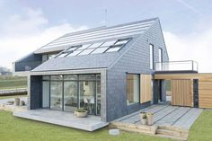 I like the windows and patios. Energy Efficient Home – A house in Aarhus, Denmark