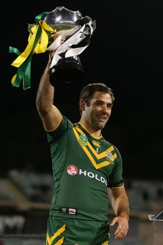Kangaroos captain Cameron Smith holds the trophy aloft after winning the ANZAC Test match between the Australian Kangaroos and the New Zealand Kiwis at Canberra Stadium on April 19, 2013 in Canberra, Australia.