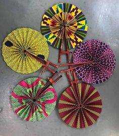 These colorful hand fans are our bestseller. Made out of leather and African print fabric they are a hot accessory for the Summer. African Inspired Fashion, African Fashion, Ankara Fashion, African Women, African Fabric, African Dress, African Attire, African Prints, African Theme