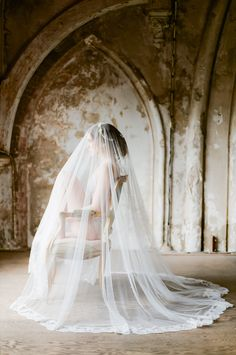 A fine art inspired bridal boudoir shoot set within a beautiful old cathedral by Anouschka Rokebrand Photography and styled by Best Day Ever Events! Veil by @sibodesigns www.sibodesigns.com