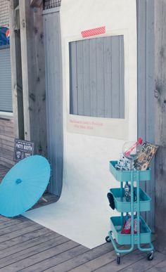Awesome photo booth setup idea // love the use of the IKEA cart and polaroid back-drop!