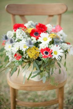 Memorial Day centerpiece with anemones, daisies, and blue thistles | Photo by Shea Christine