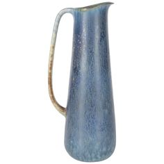 Sophisticated Mid-Century Modernist Handled Vessel by Stalhane for Rörstrand | An elegant Mid-Century Modernist handled vessel by Carl Harry Stalhane for Rörstrand. Shades of blue make-up the contours of this piece, while the appearance of patinated-like bronze can be seen along the handle and beak. A lovely object of Swedish Mid-Century ceramics.