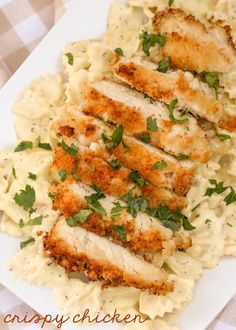 One of the yummiest recipes you'll try - Crispy Chicken! It's a favorite dinner idea. { lilluna.com } Chicken breasts in panko served over pasta with a creamy and flavorful sauce!!
