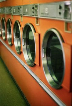 Orange retro washing machines...Would be cute hanging in laundry room