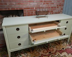 tutorial on how to turning a dresser into a media center or tv console by adding hinges to front faces of drawers
