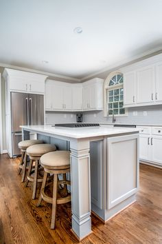 Beautiful custom island with quartz countertops and built-in stovetop.
