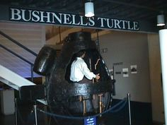 "First military ""submarine"" hand-powered, built in 1775 fitting 1 person. Designed by American, David Bushnell."