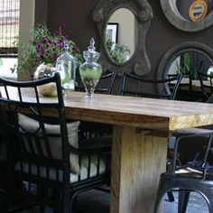 Painted black dining chairs with wood table