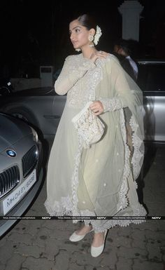 Actress Sonam Kapoor, who welcomed Bappa to her home, looked pretty in a suit styled with jhumkis and gajra.