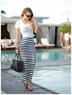 Wearing a long striped tube dress by the pool
