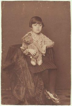 Little Girl with her Teddy Bear. Old Photo.