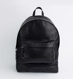 Perfect gift for those who love black. Minimalistic and elegant  rucksack made of 100% natural black leather– a unique product by Dissaq via en.DaWanda.com