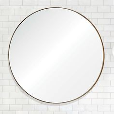Great simple round mirror with gold leaf edge. Gold-Framed Wall Mirror