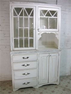 Cabinet made from architectural salvage. Gorgeous.