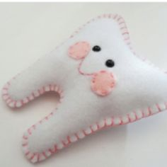 This would be a cute way to have your children put their tooth or teeth under the pillow for the toothfairy. They would know which pillow :)
