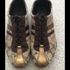 Coach Sneakers Pre-loved Coach Sneakers - Size 10, Brown, beige and gold color. A few scuffs on the toe area shown in the above photo.  Great Condition and very comfy. Coach Shoes Athletic Shoes
