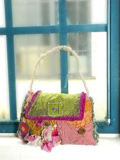 turquoise windowpane, and a cute little purse!  Nice shot, too.