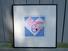 Beautiful framed quilt made from baby clothes.  Now taking orders at www.patchworkmemories.com