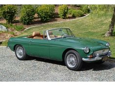 1967 Racing Green Convertible MGB GT Had one similar when my girls were little! What fun we had riding the backroads of Indiana where we were stationed at Grissom AFB.