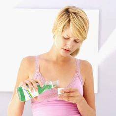 Woman pours mouthwash in cap