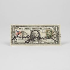Lot 42 ANDY WARHOL Andy Warhol, (1928-1987) - One Dollar, Medium: US-American one dollar bill with two canceled stamps, Est: $1,000-2,000 Signature Signed in felt pen on front and stamped 'Andy Warhol' on verso.