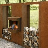 Corten steel fire place with wood storage by abk-outdoor.com