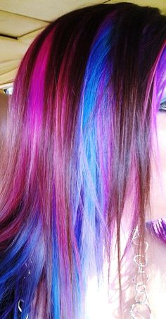Colorful hair, with shades of pink, purple, and blue.