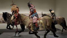 Samurai riding armored horses.