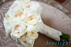 ivory roses and lace trim bouquet add a vintage chic feel