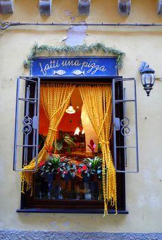 Who could resist this wonderful restaurant window , brilliant colors and gotta love the name, Fatti una Pizza