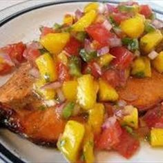 Grilled Salmon with a Pineapple, strawberry, mango salsa - reduce the olive oil to lighten the calories!