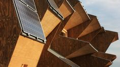 It's rare to see a building's form so adapted to maximizing renewable energy potential as . Wood Architecture, Sustainable Architecture, Amazing Architecture, Solar Panel Installation, Solar Panels, Pv Panels, Helsinki, Solar Powered Garden Lights, Barcelona
