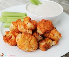 Buffalo Cauliflower Bites - YUMMY!  Not crispy or anything (not a finger food), but the flavor is nice.  Used Ken's LIght Blue Cheese dressing.
