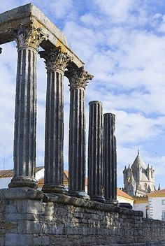 The Roman Temple of Diana and the tower of Evora Cathedral, historic centre, Evora, UNESCO World Heritage Site, Alentejo, Portugal.