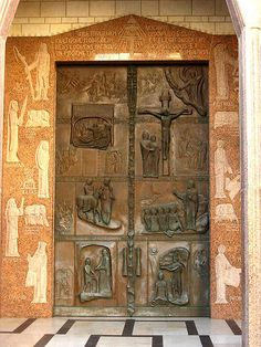 Nazareth-Church-of-the-Annunciation-front-door. It depicts the major stages of Jesus' life.