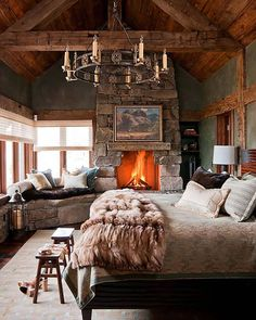 Gorgeous neutral colors bring this cozy bedroom to life...but the roaring fire doesn't hurt either! #countrystyle #neutrals #housegoals (: Yellowstone Traditions)