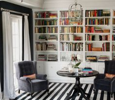 Bookshelf Wall, love the decor minus the carpet.