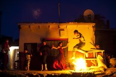 "A young Turkish gypsy stand jumps over a fire during the celebration of the annual Spring Festival ""Hidirellez"" on May in Edirne, south-western Turkey. Gypsies celebrate the beginning of the spring season according to their calendar. Hidirellez is celebrated as the day on which Prophets Hizir (Al-Khidr) and Ilyas (Elijah) met on earth. (Gurcan Ozturk/AFP/Getty Images)"