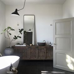 Bathroom with an antique Chinese cabinet. Who wouldn't love to get ready for the day in a like this? It's all about mixing materials, tones and styles. I love how the old cabinet matches the modern design of. Bad Inspiration, Bathroom Inspiration, Interior Inspiration, Beautiful Bathrooms, Bathroom Interior, Modern Bathroom, Cheap Home Decor, Home Decor Accessories, Interior And Exterior