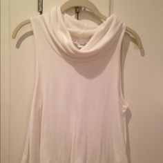 Urban outfitters loose turtlneck White cropped loose urban outfitters tank top. Off white only worn once for an event Brandy Melville Tops Tank Tops